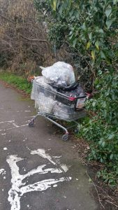 A picture of a trolley containing collected litter from an Epsom Footpath